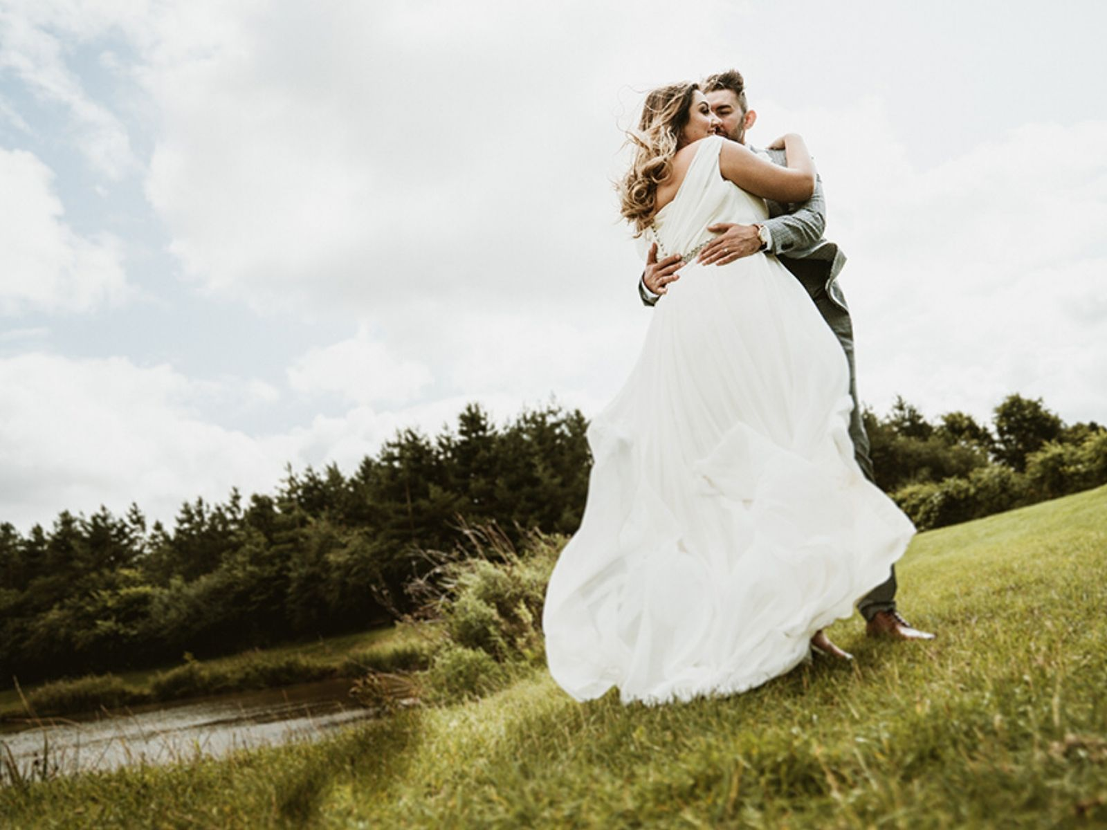 Aimee and Joe hugging at their outdoor wedding photography shoot