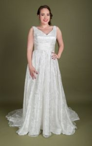 Designer satin bridal gown by Millie Grace from Stratford-Upon-Avon garden centre wedding dress shop Boho Bride boutique Stratford