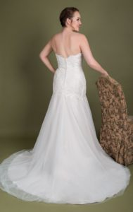 Plus size lace fit-and-flare designer Millie Grace wedding dress from the back