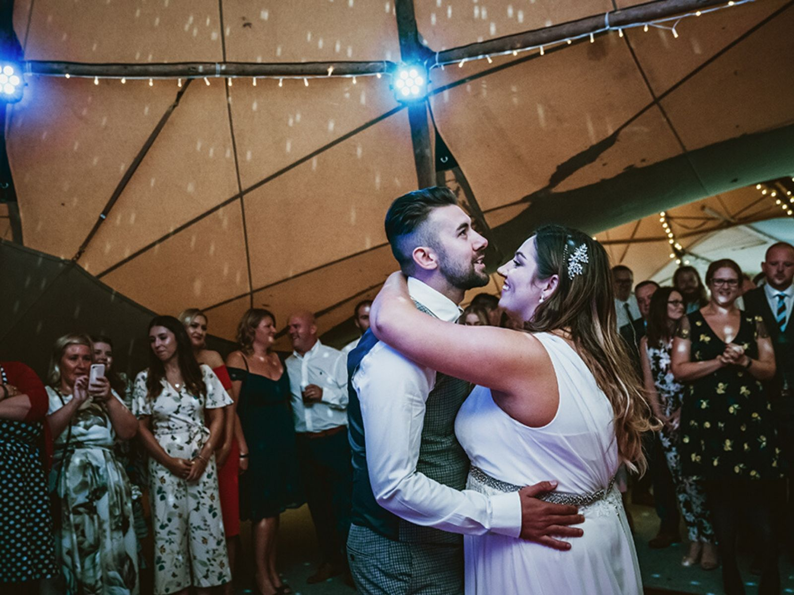 Aimee and Joe sharing their first dance at their tipi wedding venue