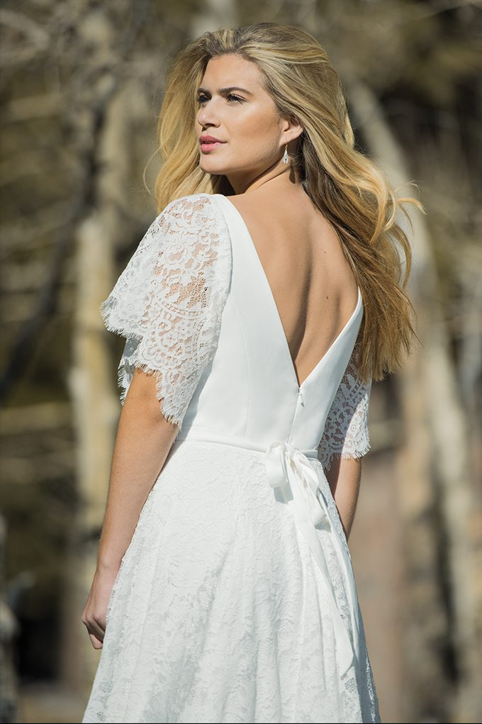 Designer wedding dress with open V-back by Ivory and Co