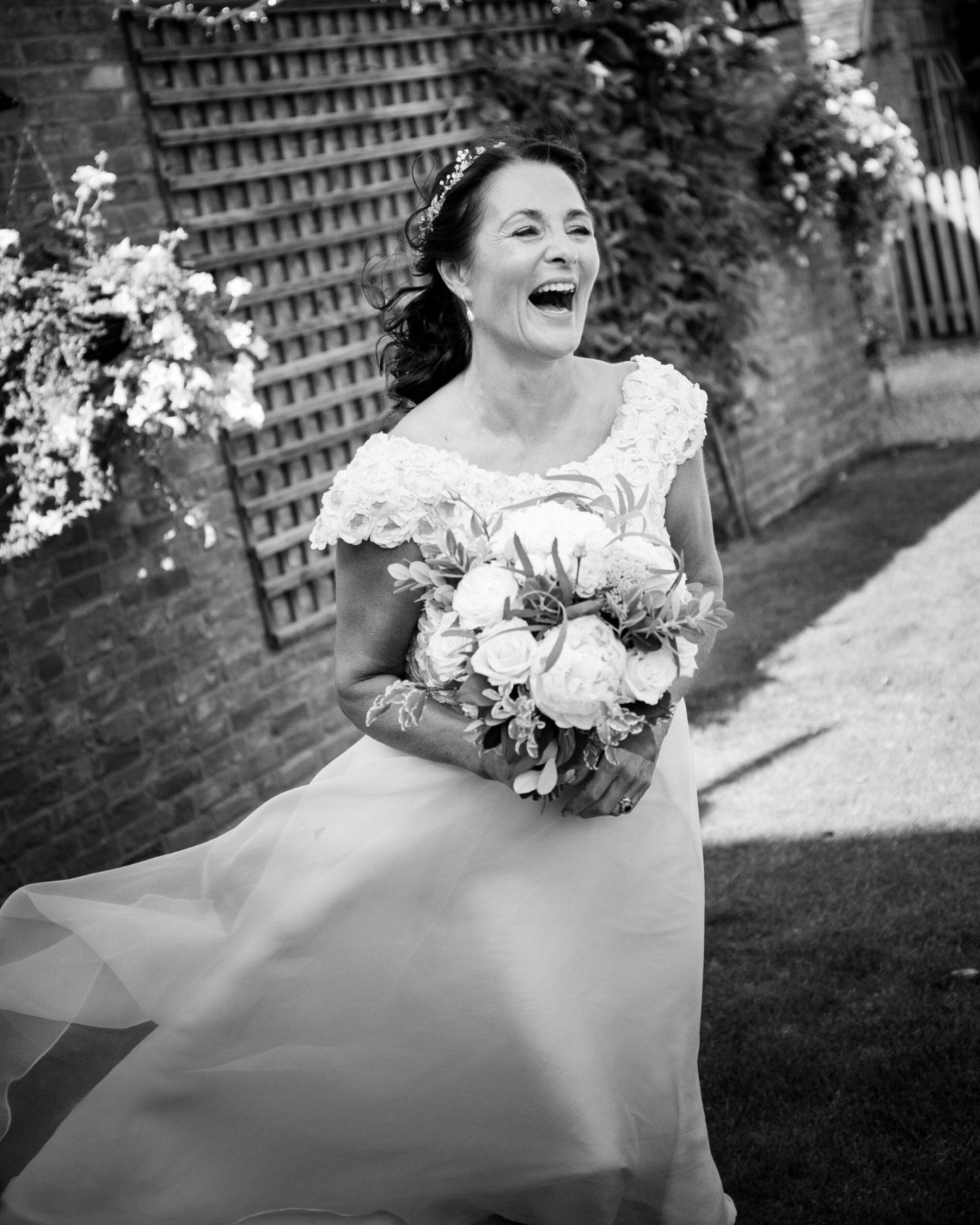 Boho Bride wearing bespoke wedding dress with lace bolero from Boho Bride