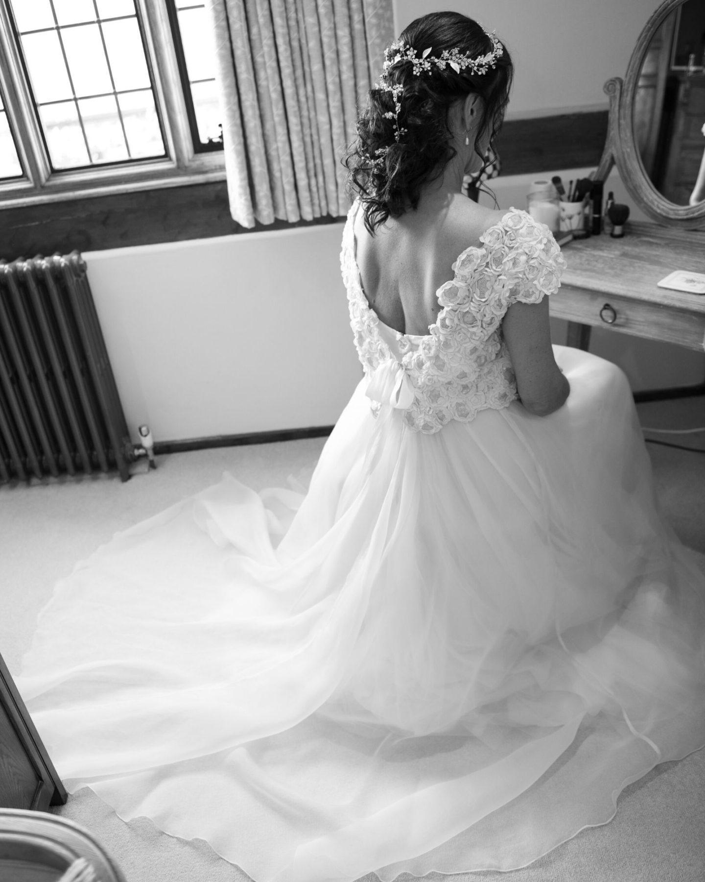 bride wearing bespoke lace wedding dress from boho bride bridal boutique in Stratford Upon Avon