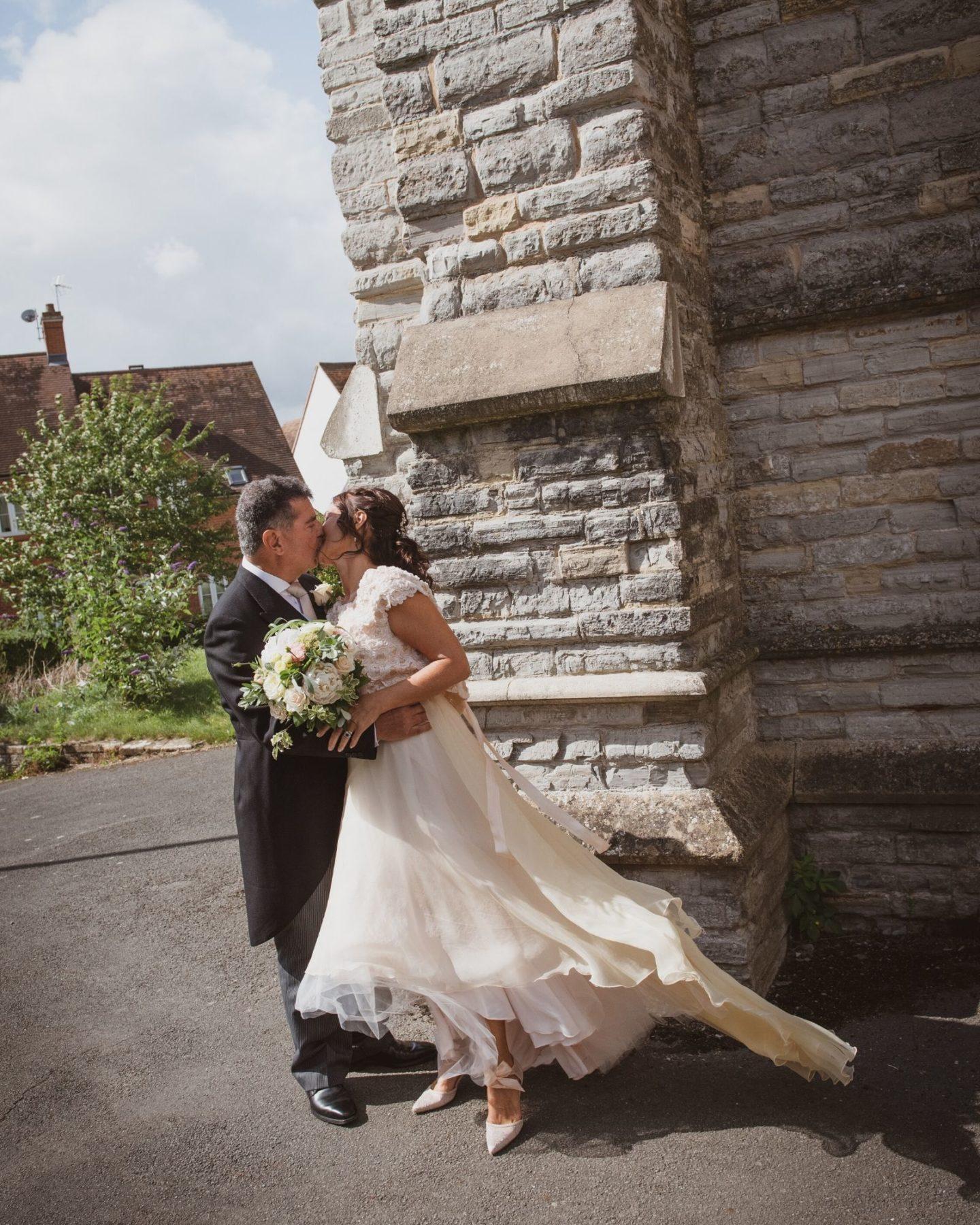 Bride wearing bespoke wedding dress from Boho Bride Boutique in Stratford-Upon-Avon