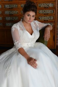 Curvy sleeved Lois Wild wedding dress in Stratford-Upon-Avon