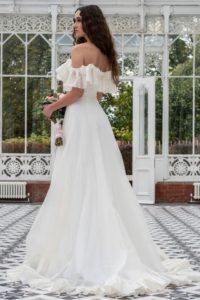 Off-the-shoulder Freda Bennet wedding dress for plus size bride in Stratford-Upon-Avon