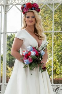 Plus-size designer wedding dress for curvy bride at Stratford-Upon-Avon wedding dress shop