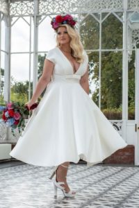 Plus size tea length wedding dress for curvy bride at Stratford-Upon-Avon wedding dress shop