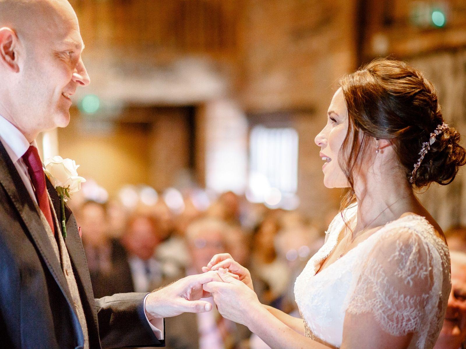 Exchanging vows at wedding venue Curradine Barns Shrawley