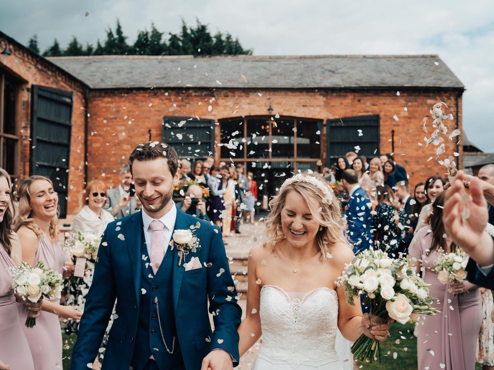 Couple leaving Mickleton Hills Farm wedding venue in Chipping Campden