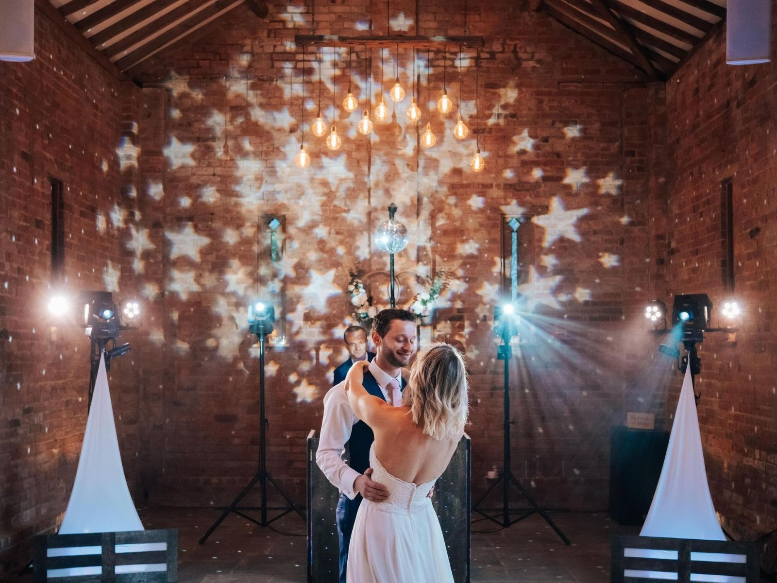 Couple sharing their first dance at relaxed barn wedding