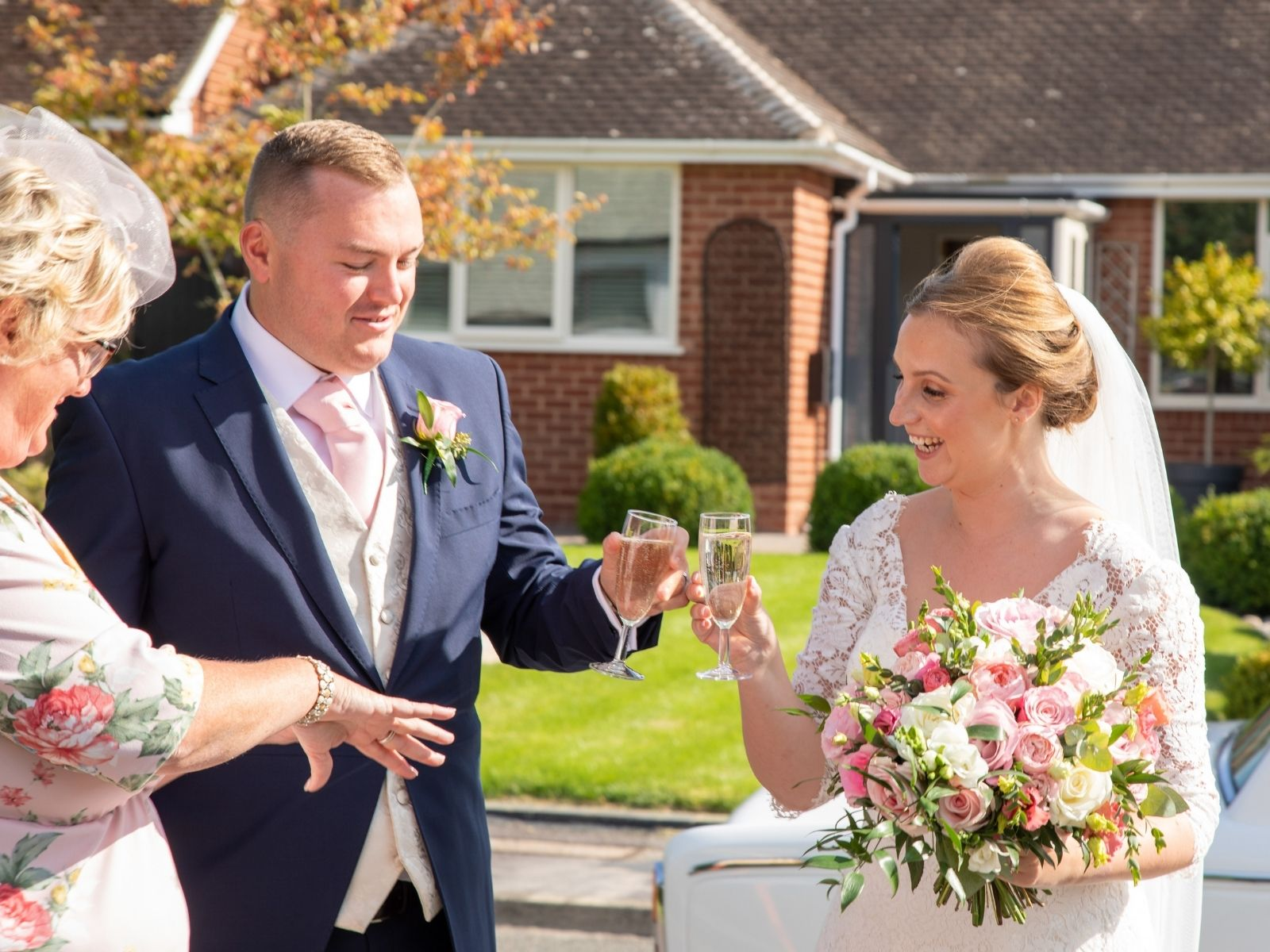 Rachel and Shaun clinking champagne glasses after their wedding ceremony