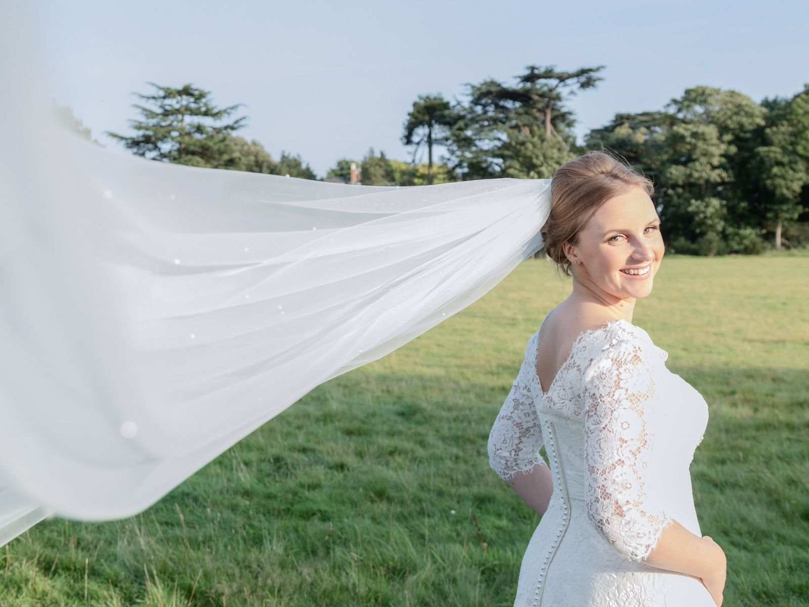 Rachel in her sleeved lace wedding dress