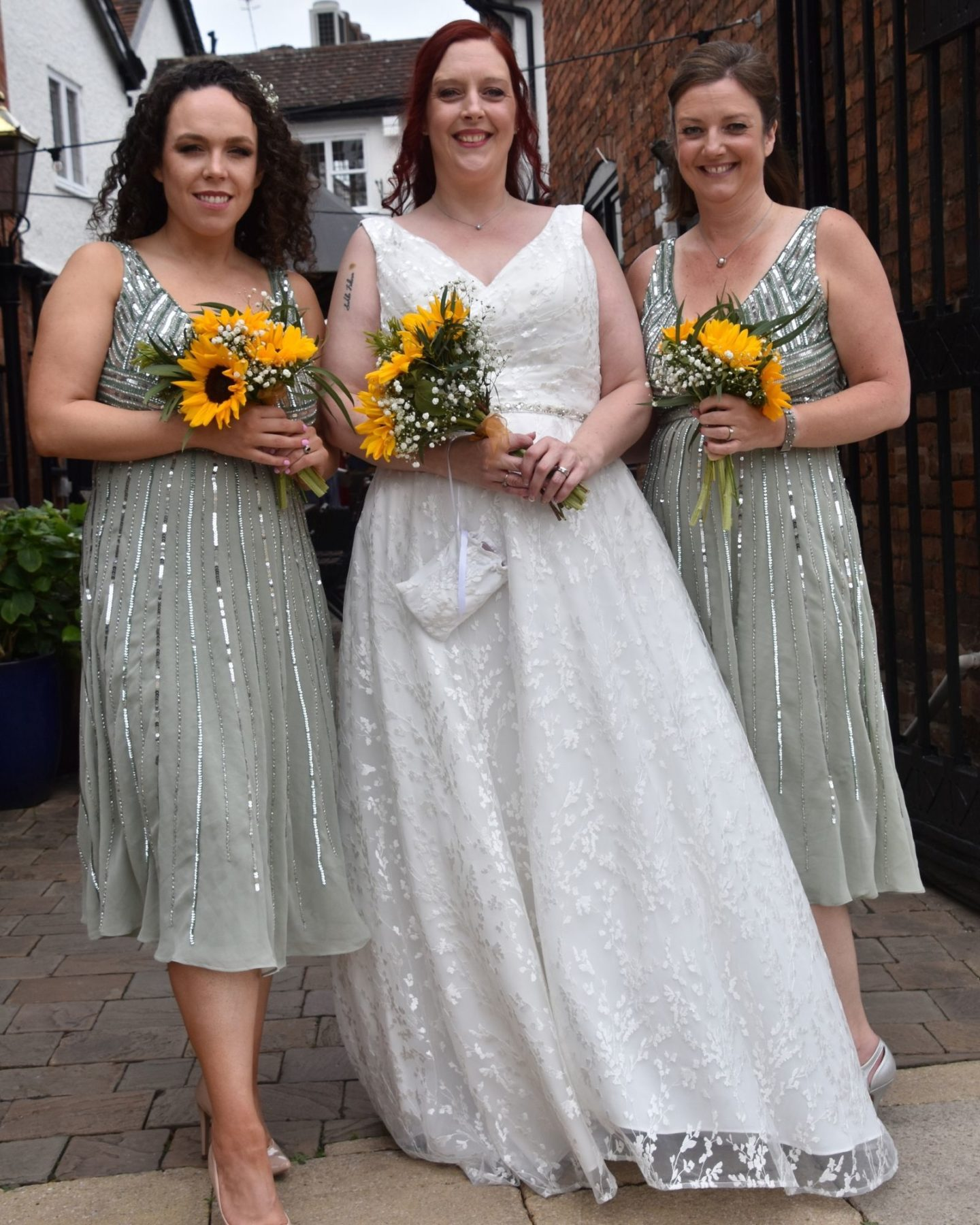 Alternative bride with her bridesmaids in green bridesmaid dresses